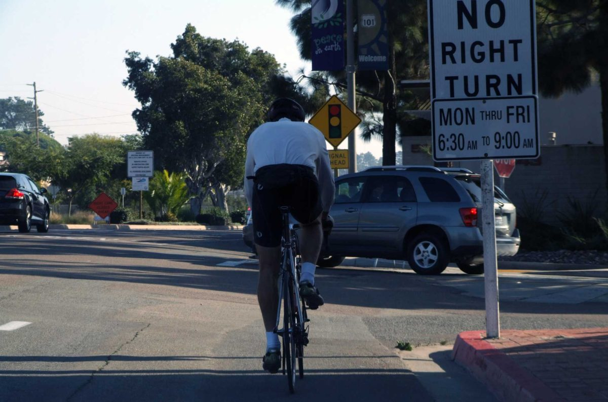 San Diego bicyclist on Hwy 101 bike lane busy intersections